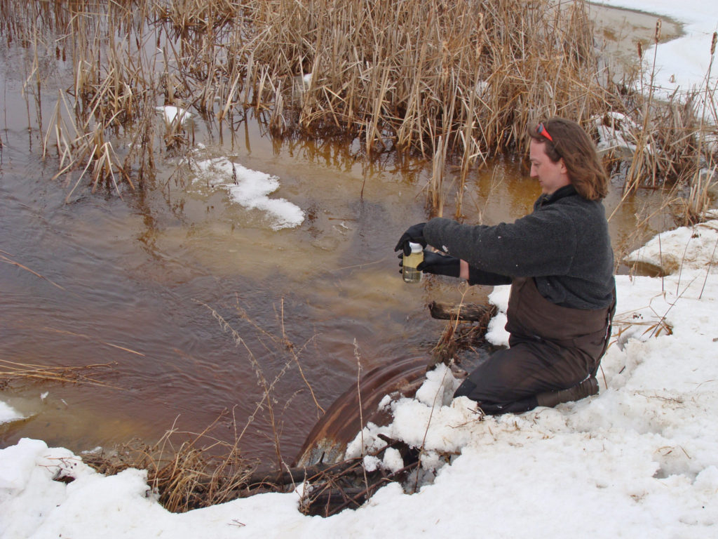 IWWR researcher Pascal Badiou takes a water sample.